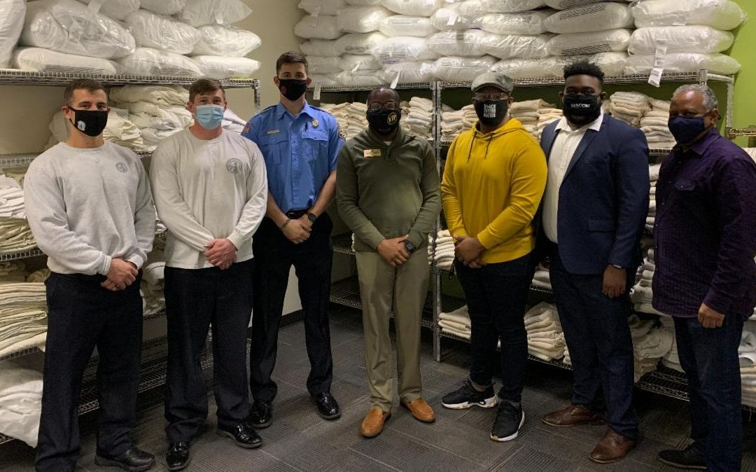 Local chapter of Alpha Phi Alpha Fraternity volunteering Monday at Brookdale Warming Center