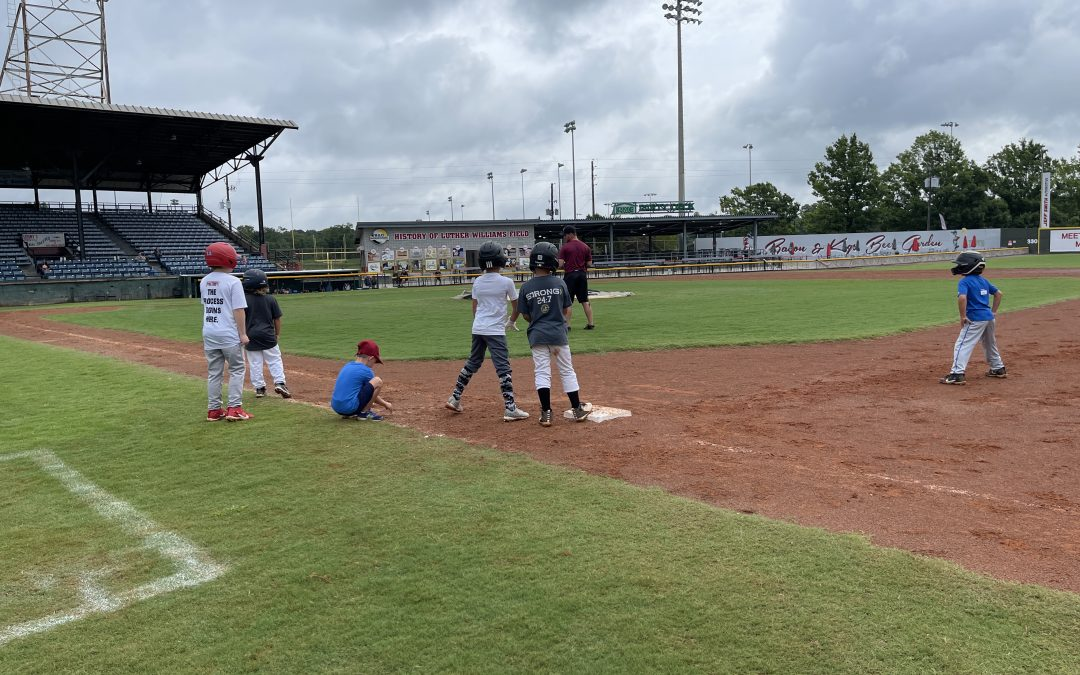 Batter up! Bacon Bits to the plate: Macon Bacon holds camp for kids